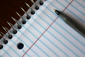 Pen and notebook paper