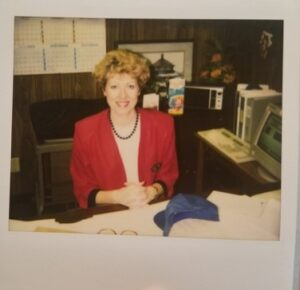 Women sitting at her work desk.