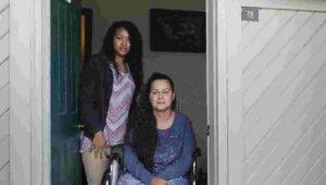 Shylah and Tamara in a doorway.